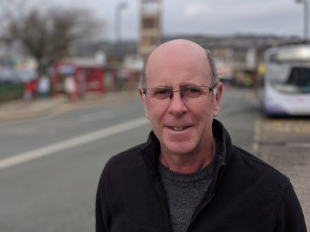 Green Party Councillor Martin Love standing in Shipley Market Place