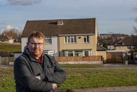 Matt Edwards standing in front of a semi-detached house on Fairfax Avenue, Bierley.
