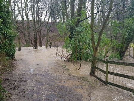 Flooding in the Tong Valley at Springfield Lane at Tong Beck. The beck has burst its banks.