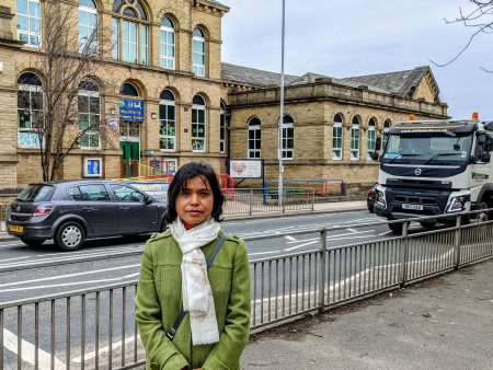 Haearun Hussain standing outside Wycliffe School with traffic on Saltaire Road